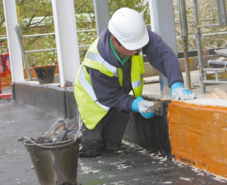 Mastic Asphalt application to an upstand - IKO Permaphalt
