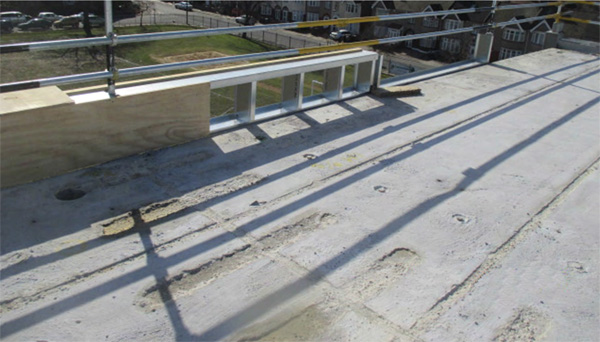 Heavy weight concrete roof deck over a masonry structure