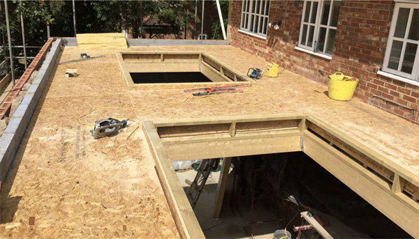Lightweight timber roof deck over a brickwork structure