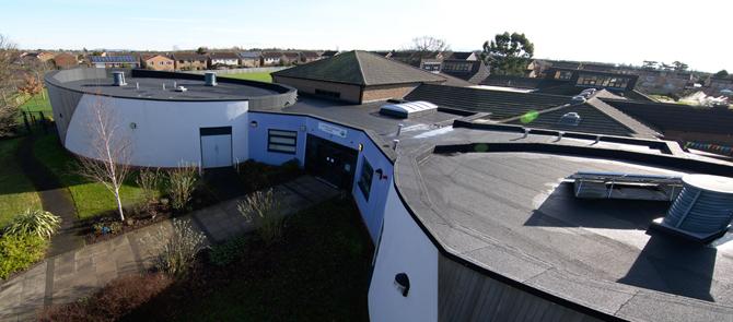 designing flat roofs school reroofing
